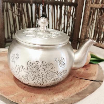 匠义-足银本色茶具-菊花端把壶