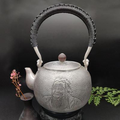 艺魂足银本色檀木茶具-孔子提梁壶(檀木壶钮)锤纹工艺